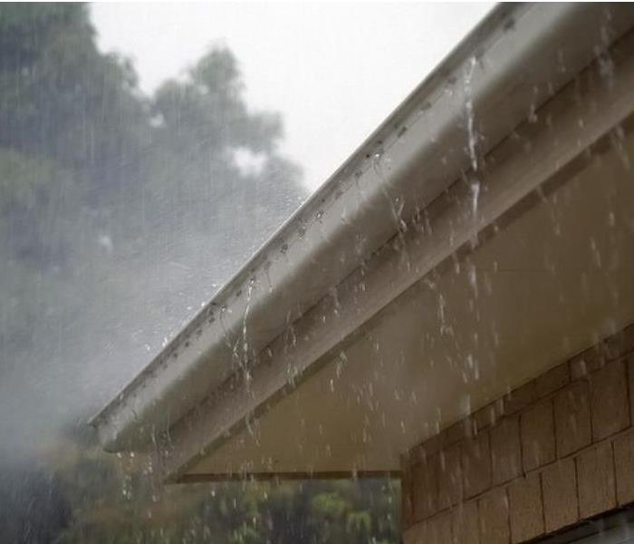 Functioning rain gutter prevents storm damage