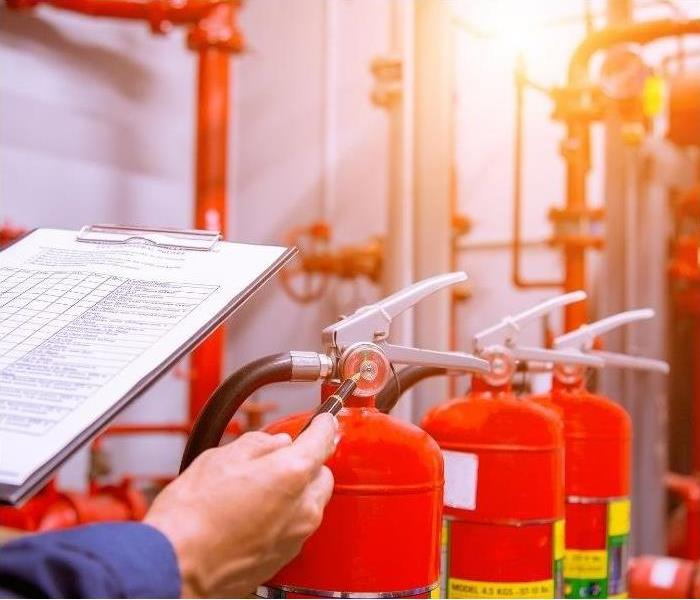 Making sure fire extinguishers are functional and up to date for commercial building safety